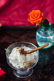 Delicious ice cream dessert in glass over black surface. Royalty Free Stock Photography
