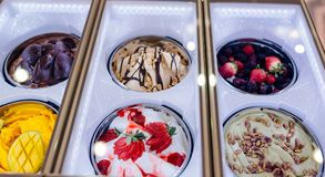 Delicious ice cream on display. In a confectionery shop royalty free stock photos