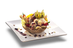 Delicious ice cream sundae with fresh fruits in wafer bowl decor Royalty Free Stock Photography