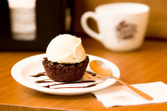 Delicious icecream on top of a brownie with a chocolate sauce in the plate Stock Photography