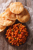 Delicious Indian Chana masala and puri close-up. Vertical top vi Stock Images