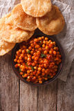 Delicious Indian Chana masala and puri. Vertical top view Stock Photography