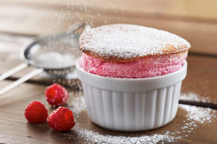 Delicious individual raspberry souffle Stock Photos