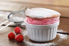 Delicious individual raspberry souffle. Homemade delicious individual raspberry souffle stock photos