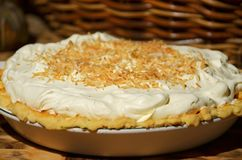 Delicious inviting homemade traditional coconut cream pie Stock Photography