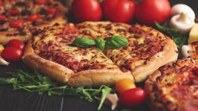 Delicious italian or american style pizaas composition stock video
