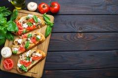 Delicious Italian antipasti chopped tomatoes, champignons, ricot stock photos