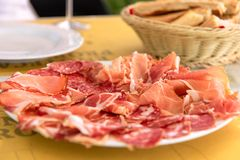 Delicious Italian appetizer. Tasty meat dishes: ham, salami, pro stock photography