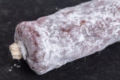 Delicious italian felino salami stick. Royalty Free Stock Photos