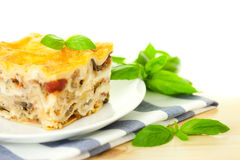 Delicious Italian Lasagna / with fresh basil Royalty Free Stock Images