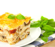 Delicious Italian Lasagna / with fresh basil Royalty Free Stock Photo