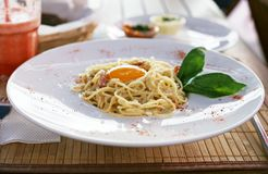 Delicious Italian pasta carbonara on a white plate Royalty Free Stock Photo