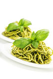 Delicious italian pasta with pesto sauce Stock Images