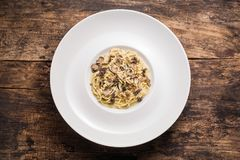 Delicious Italian pasta with truffles.  Spagetti with truffle mushrooms on the wooden vintage background. Top view. Delicious Italian pasta with truffles Stock Photography