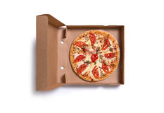 Delicious Italian pizza with ham and tomatoes in box Royalty Free Stock Photos