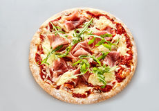 Delicious Italian pizza with parma ham and rocket royalty free stock photos