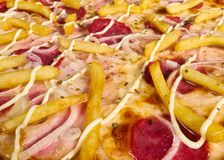 Delicious Italian pizza with potatoes close-up stock images