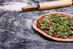 Delicious italian pizza on rustic wooden background, copy space. Royalty Free Stock Images