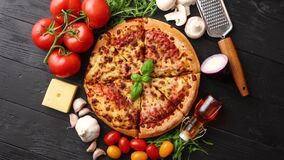 Delicious italian pizza served on black wooden table stock video footage