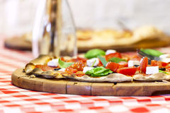 Delicious Italian pizza served on wooden board. Stock Photos