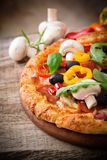 Delicious italian pizza. Served on wooden table stock photography