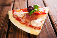 Delicious italian pizza served on wooden table Stock Photography