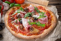 Delicious italian pizza served on wooden table Royalty Free Stock Image