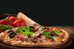 Delicious italian pizza served on wooden table Royalty Free Stock Photography