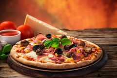 Delicious italian pizza served on wooden table Stock Images