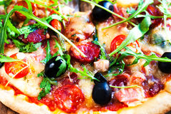 Delicious italian pizza served on wooden table close up, ihot an royalty free stock images