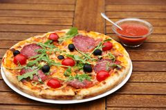 Delicious italian pizza served on wooden table Royalty Free Stock Photos