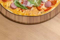 Delicious italian pizza served on wooden table royalty free stock images
