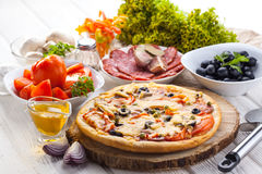 Delicious italian pizza served on wooden table Royalty Free Stock Photo