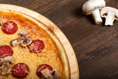 Delicious italian pizzas served on wooden table Stock Image