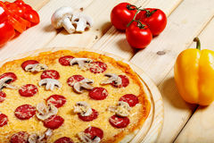 Delicious italian pizzas served on wooden table Royalty Free Stock Images
