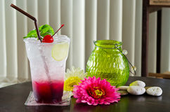Delicious Italian soda  topped with one red cherry Stock Images