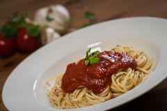 Delicious Italian spaghetti with tomato sauce Royalty Free Stock Photos