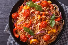 Delicious Italian spaghetti with vegetables macro, top view Stock Photography