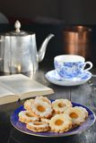 Delicious jam cookies with cup of English tea Royalty Free Stock Photography