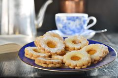 Delicious jam cookies with cup of English tea Royalty Free Stock Photo