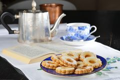 Delicious jam cookies with cup of English tea Stock Photos