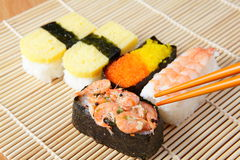 Delicious japan sushi mix with chopsticks Royalty Free Stock Images