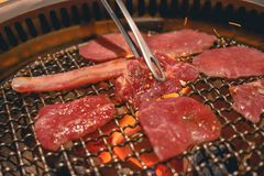 Delicious Japanese beef being grilled on a grill on wooden coal close up royalty free stock photos