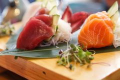 Delicious Japanese dish of aphrodisiac food. Hirame sashimi,salmon sashimi and tuna sashimi dish stock photography