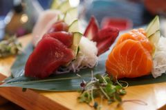 Delicious Japanese dish of aphrodisiac food. Hirame sashimi,salmon sashimi and tuna sashimi dish stock image