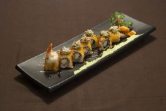 Delicious japanese fusion food with shrimp. On a black plate royalty free stock photo