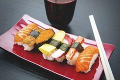 Delicious Japanese sushi with chopsticks Stock Image
