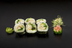 Delicious Japanese sushi rolls decorated with seaweed salad and Stock Image