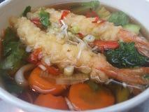 Delicious Japanese tempura udon soup. Japanese tempura shrimps with udon soup stock photo