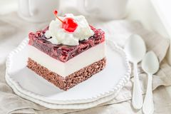 Delicious jelly cherries cake. On old whhite table stock images